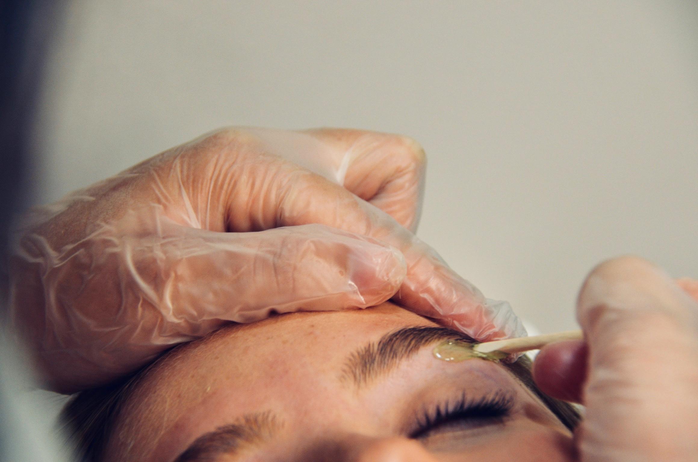 Eyebrow wax at a facial franchise
