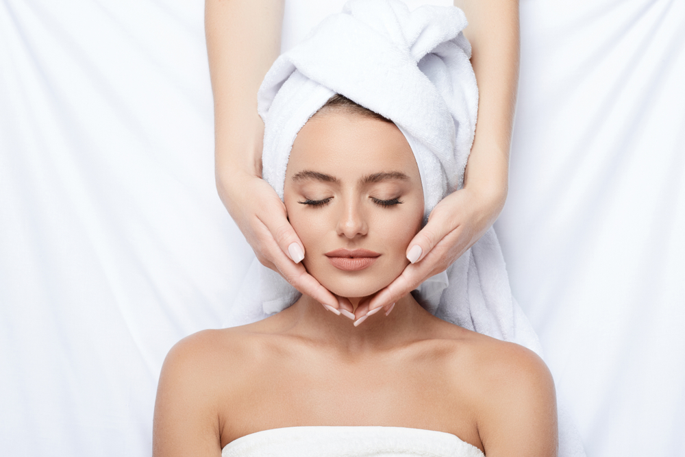 Woman at a massage franchise for a facial