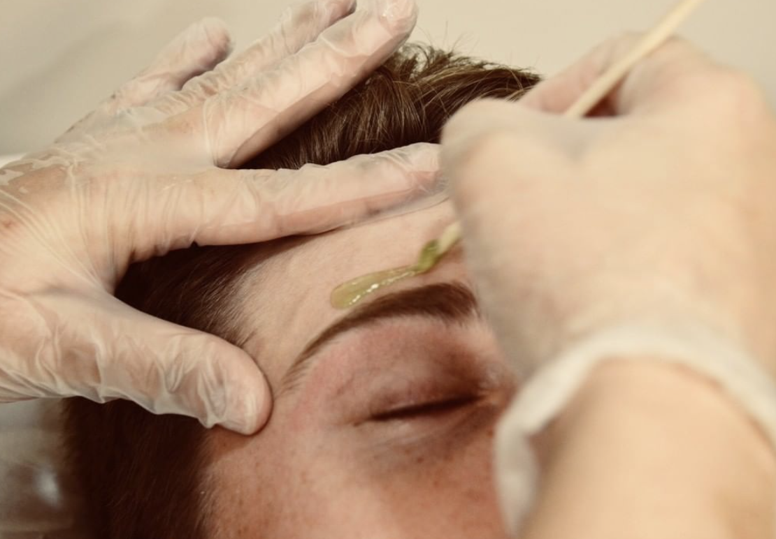 Customer getting waxed instead of going to a sugaring franchise
