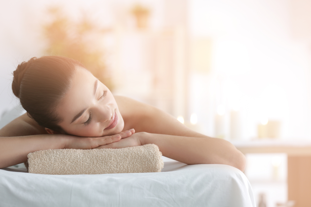 Woman enjoying a spa after following the opening a spa checklist